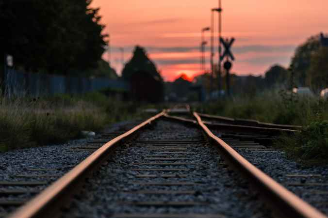 shallow focus photography of railway during sunset